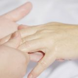 Rubbing moisturiser into a hand