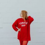 Women in red outfit with slogan 'tomato soup'