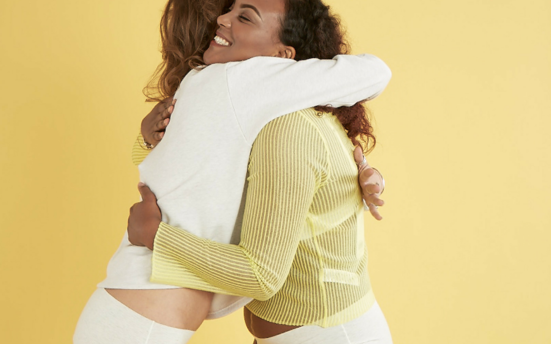 women hugging in solidarity, sisterhood