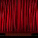 Red stage curtains in the theatre