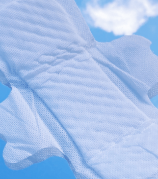 TOTM's light flow organic cotton pad out of wrapper on a blue background with cloud