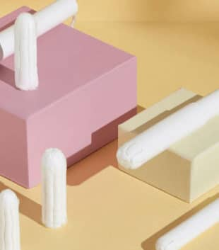 TOTM organic cotton cardboard applicator tampons on an orange background